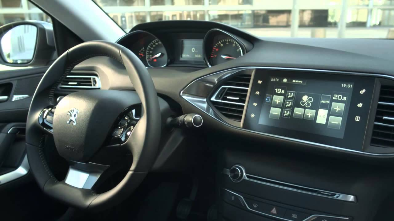 astounding-design-of-the-black-dash-added-with-black-steering-wheels-as-the-peugeot-308-2014-interior