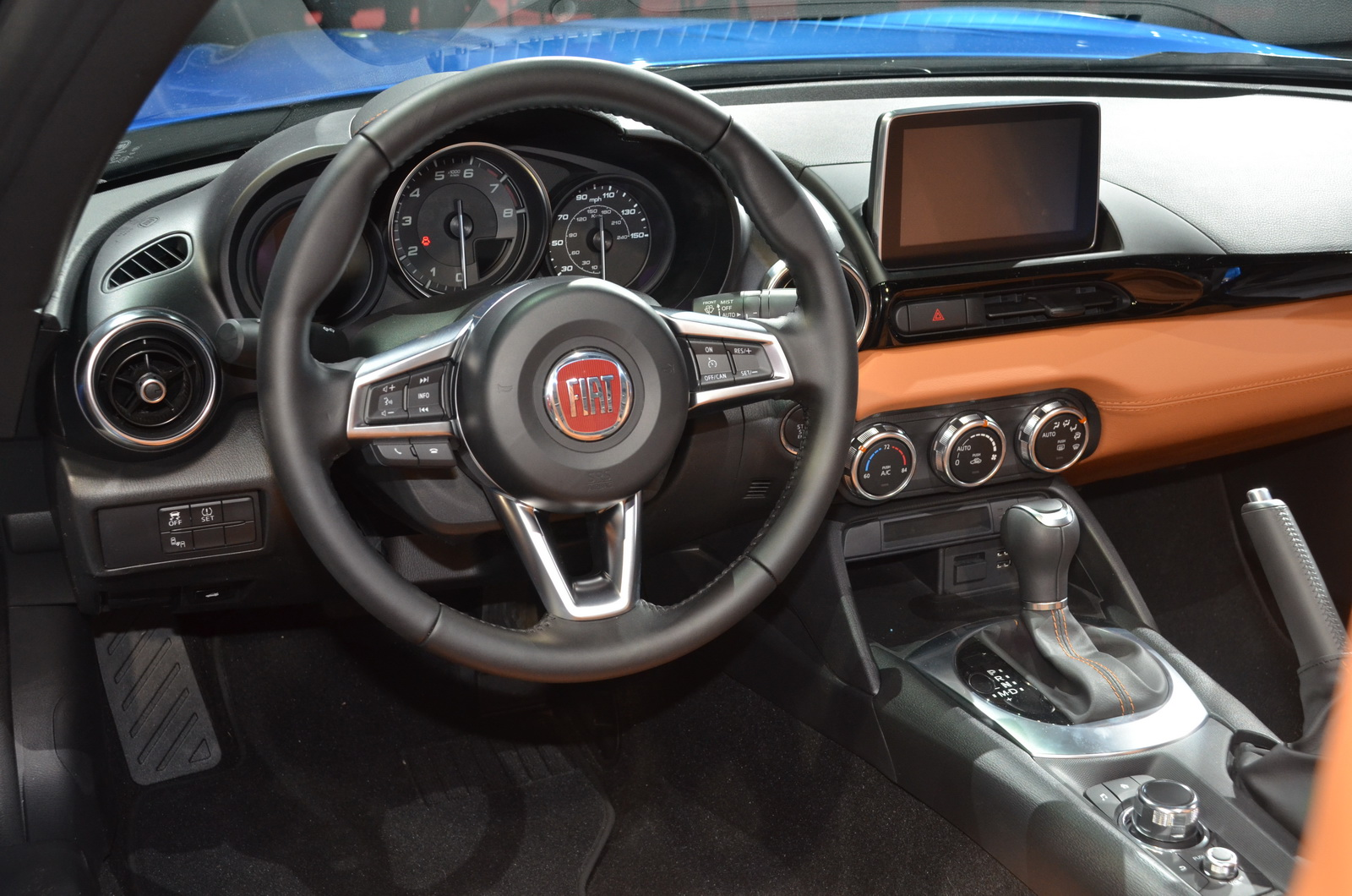 awesome-desig-of-the-brown-dash-with-black-steering-wheels-as-the-fiat-124-spider-2016-interior