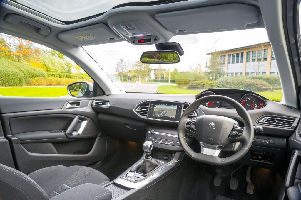 awesome-design-of-the-silver-accent-of-the-black-steering-wheels-as-the-peugeot-308-2014-interior-with-black-dash-ideas