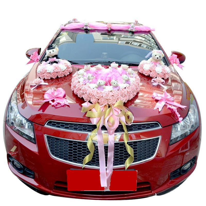 marvelous-design-of-the-red-cars-added-with-pink-flower-ideas-as-the-car-decoration-for-wedding