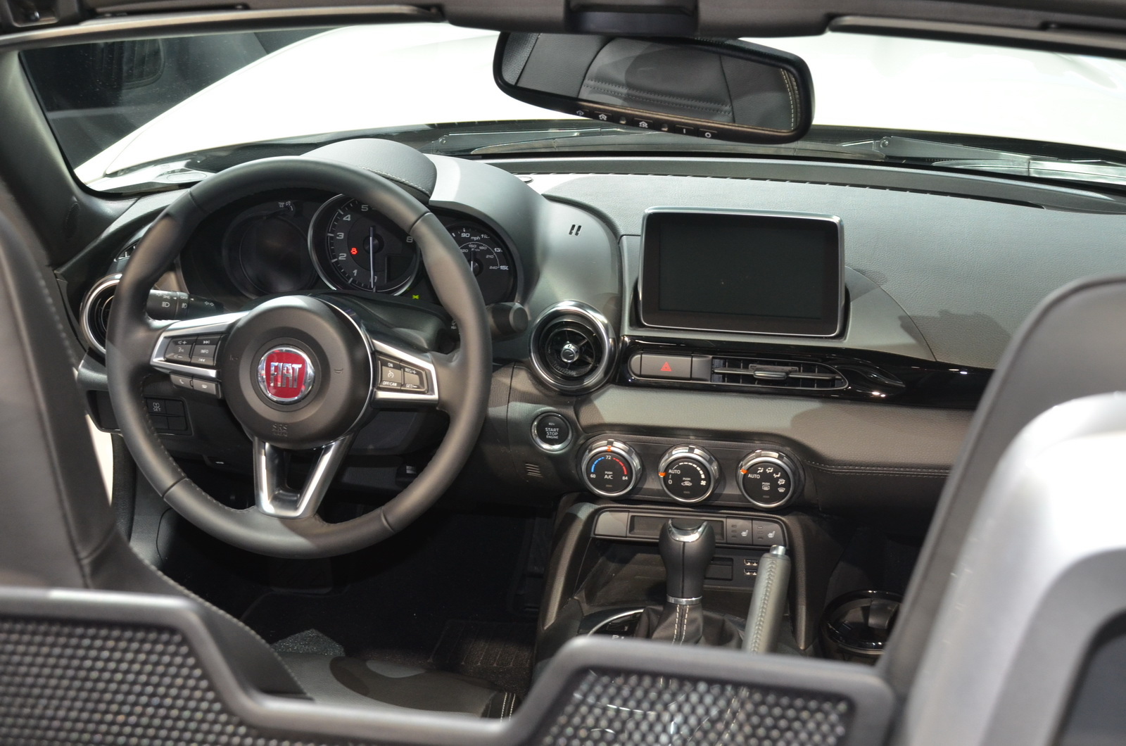 stunning-design-of-the-black-dash-and-black-stering-wheel-as-the-fiat-124-spider-2016-interior