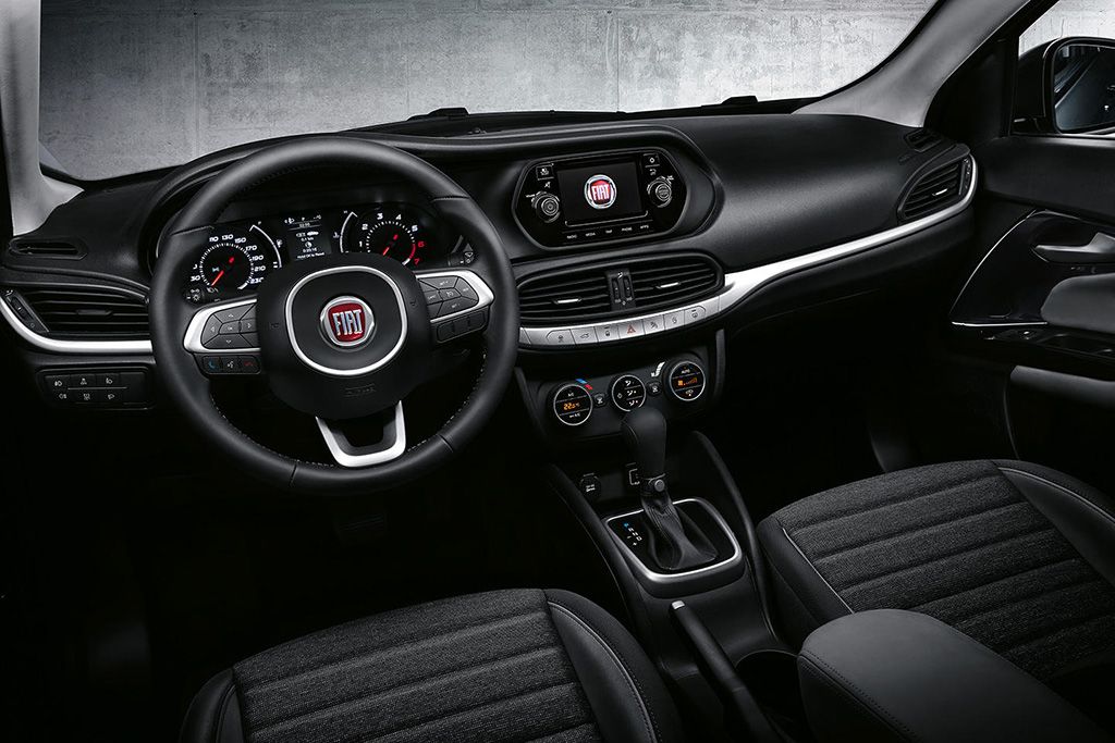 stunning-design-of-the-black-dash-with-silver-accent-added-with-black-steering-wheel-as-the-fiat-fullback-2016-interior