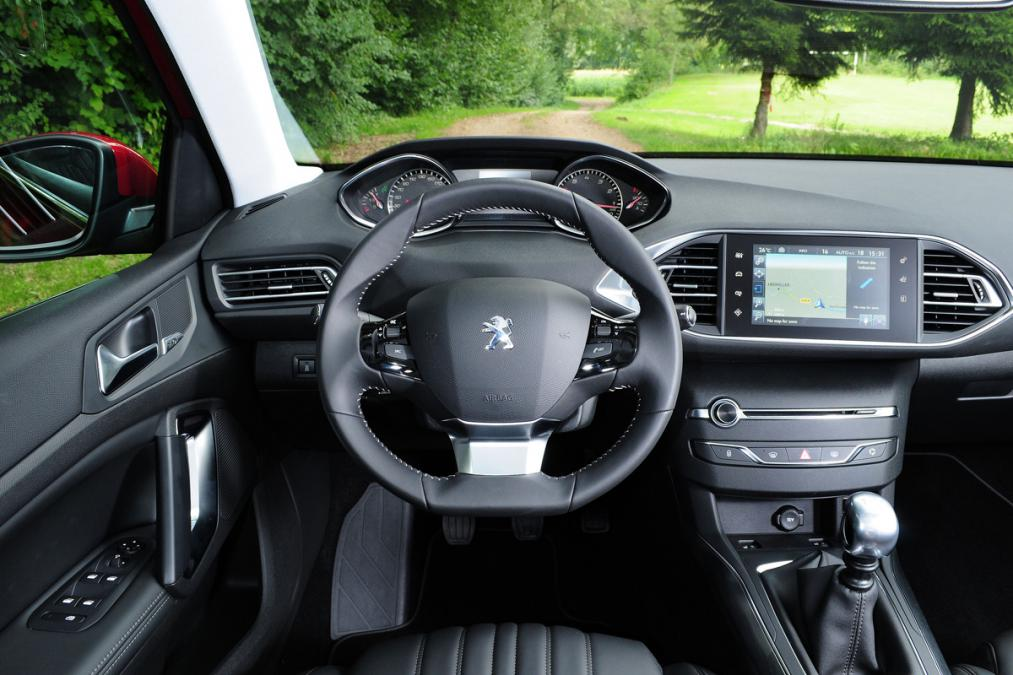 superb-design-of-the-black-dash-ideas-with-silver-accents-added-with-black-seats-as-the-peugeot-308-2014-interior
